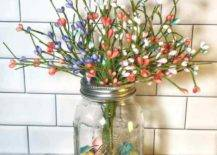 Colorful eggs inside a mason jar with flowers