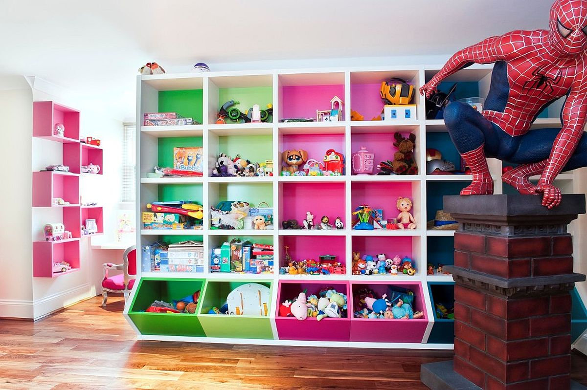 Colorful wall of shelves creates a fabulous focal point in this kids' room and playarea