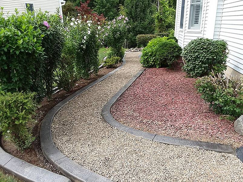 Concrete edging and stone pathway