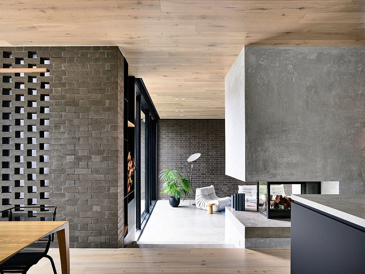 Contemporary interior of the home in concrete, brick, glass and timber