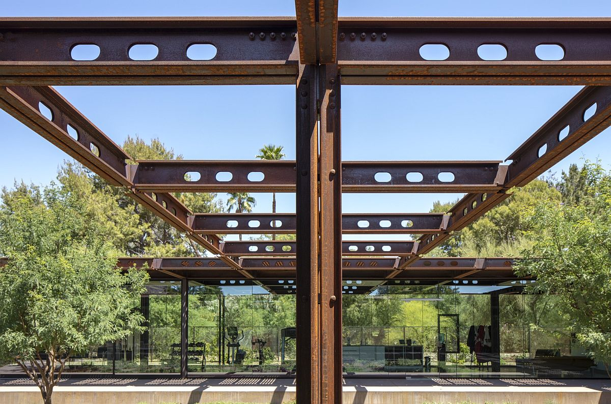 Corten steel beams extend the home outdoors into the courtyard and offer a world of possibilities