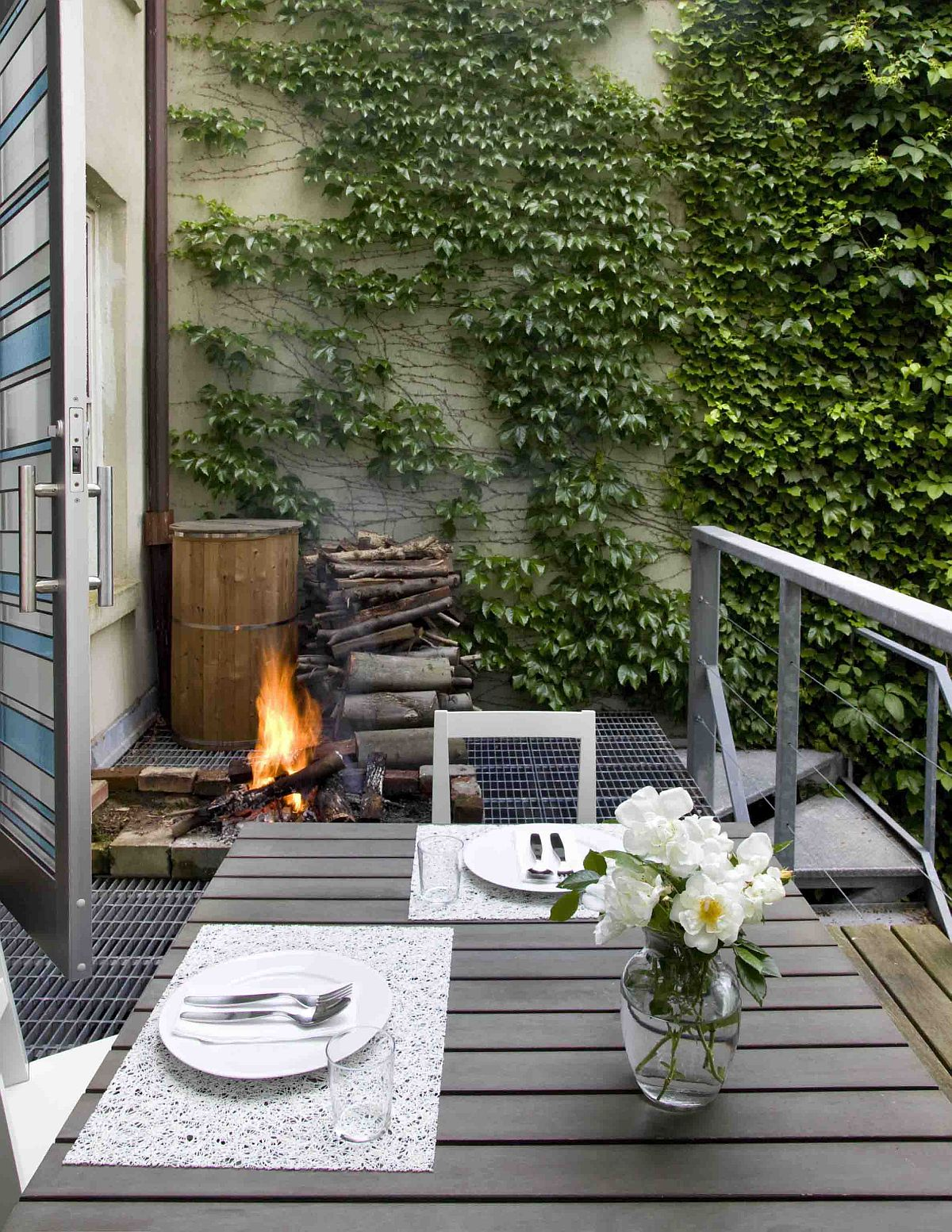 Cozy and comfortable small contemporary deck with a fireplace