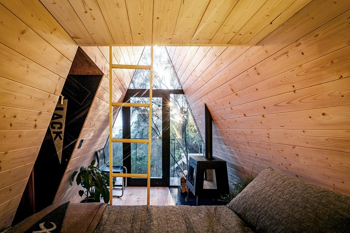 Cozy interior of the brilliant treehouse that is lined with Baltic Pine