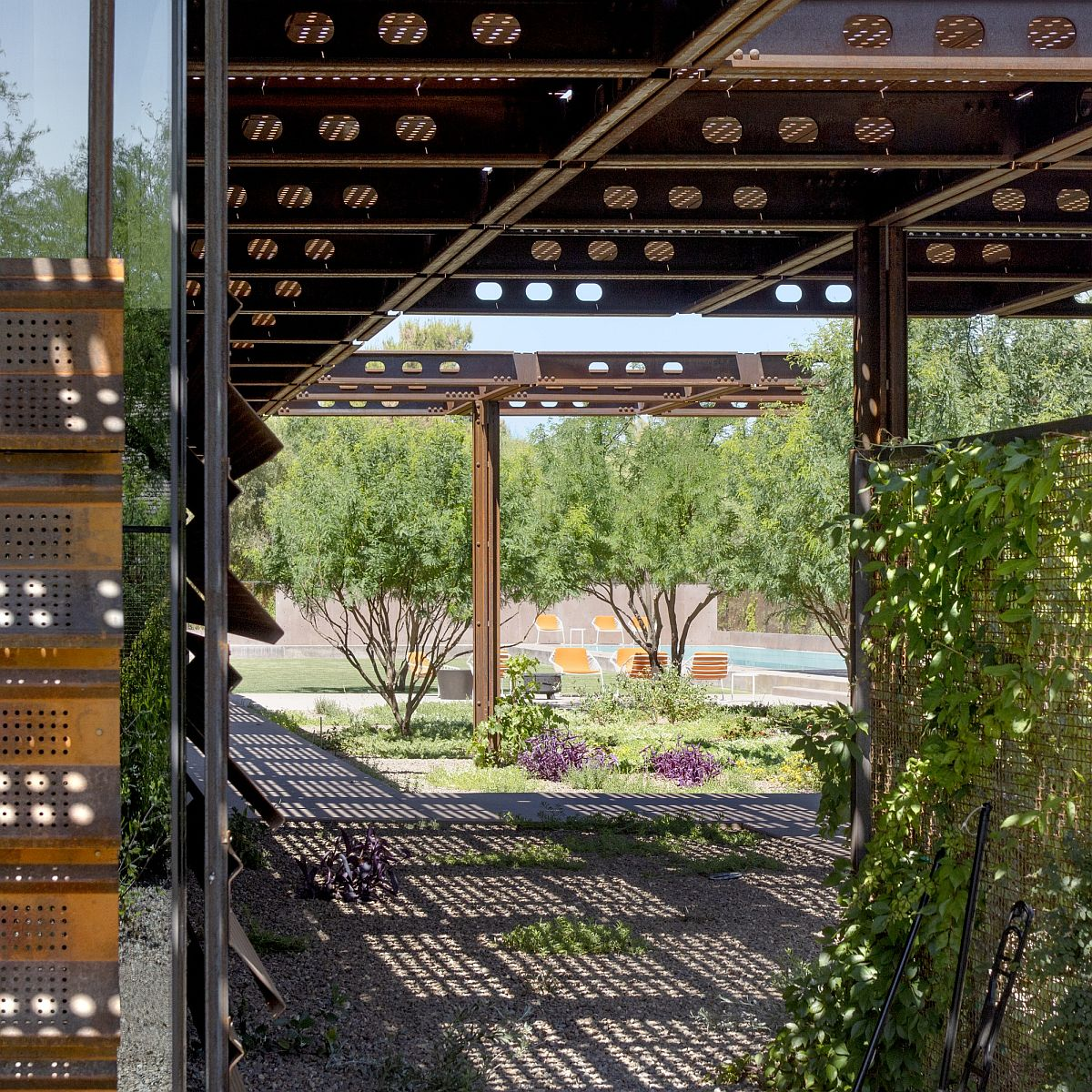 Custom shade coupled with the corten steel framework bring filtered light indoors