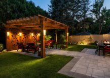 Custom-wooden-panels-with-apttern-and-warm-lighting-shape-this-tropical-style-pergola-14895-217x155