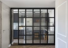Dark-framed-sliding-glass-doors-separate-the-living-area-from-the-kitchen-76787-217x155