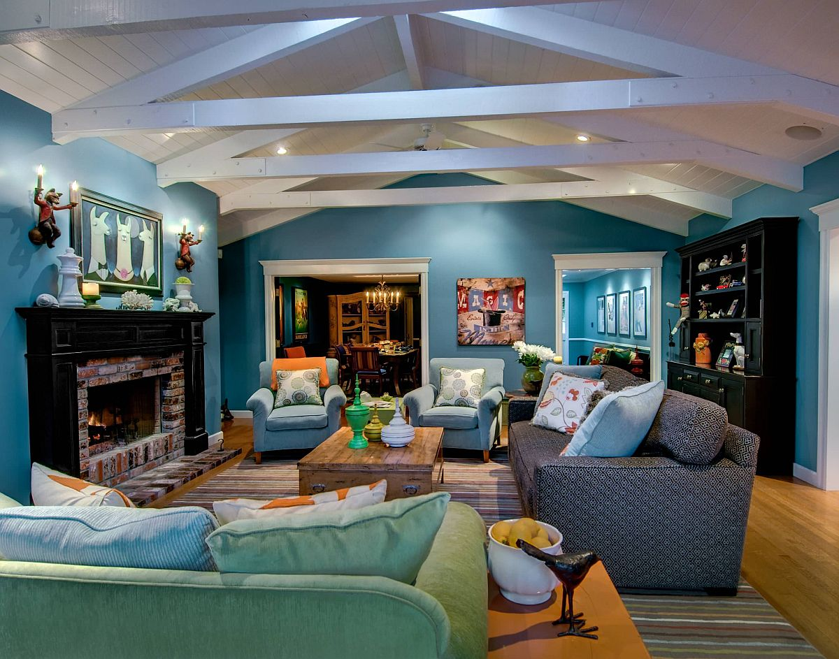 Different shades of teal make an impact in this spacious modern living room
