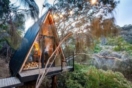 Small A-Frame Treehouse in the Woods made from Recycled Materials