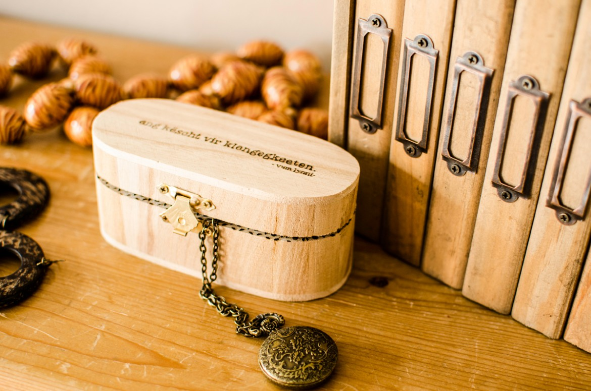 Engraved wood jewelry box with locket