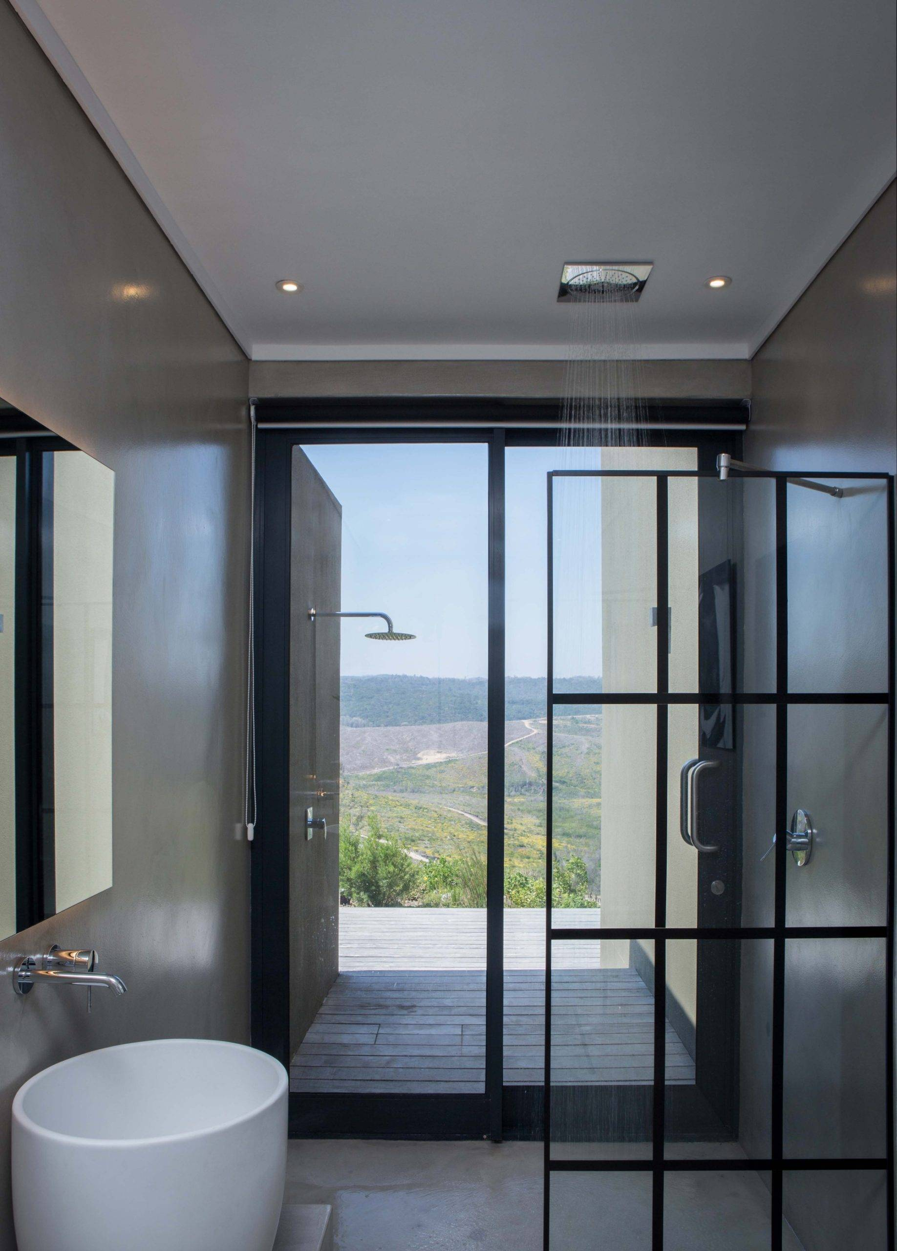 Exquisite contemporary bathroom in gray and white with glass partition