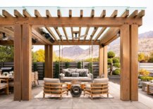 Exquisite-wooden-pergola-structure-with-ceiling-fan-and-comfy-outdoor-decor-28229-217x155