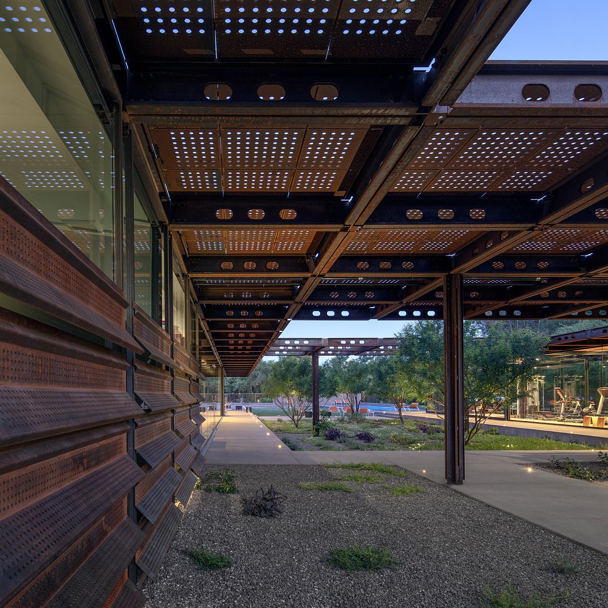 Extended Corten steel roof of the home that adds shade to the outdoor hangouts