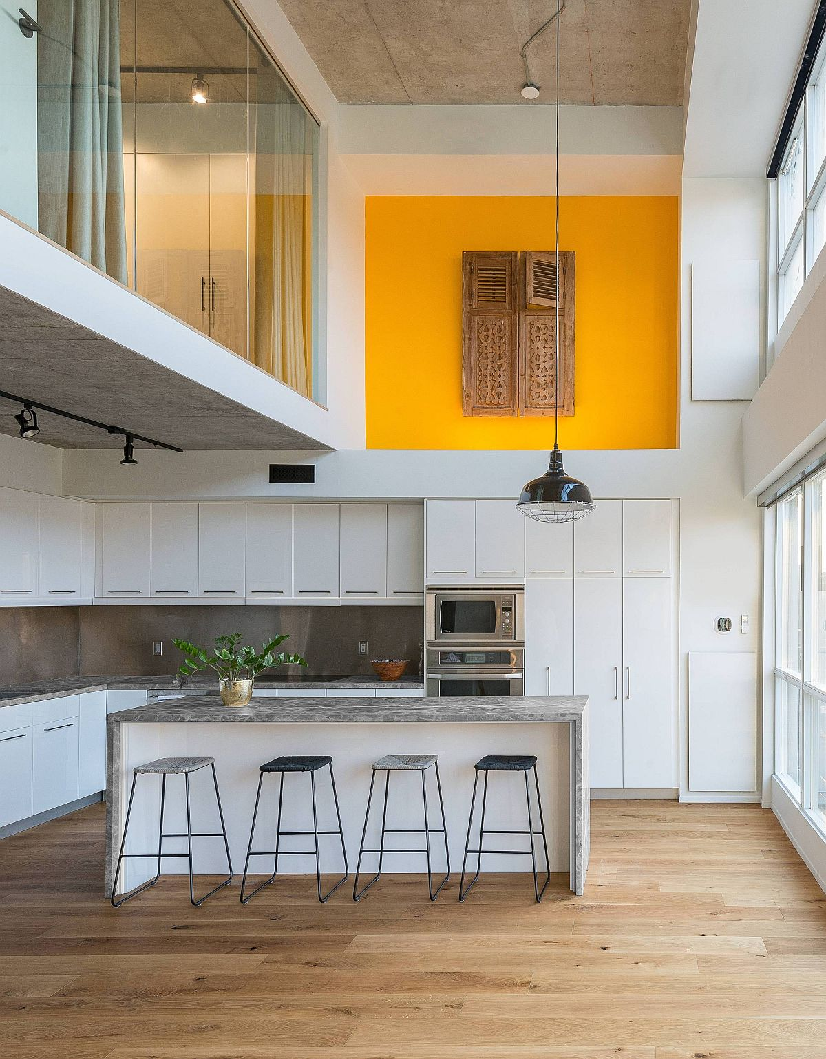 Fabulous contemporary kitchen with double-height deisgn and a splash of yellow