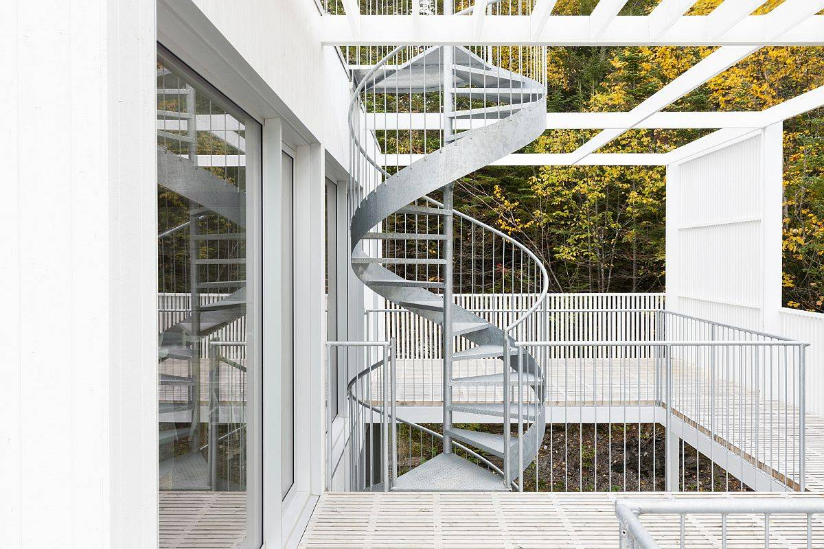 Fabulous metallic spiral staircase connects the three different levels of the house