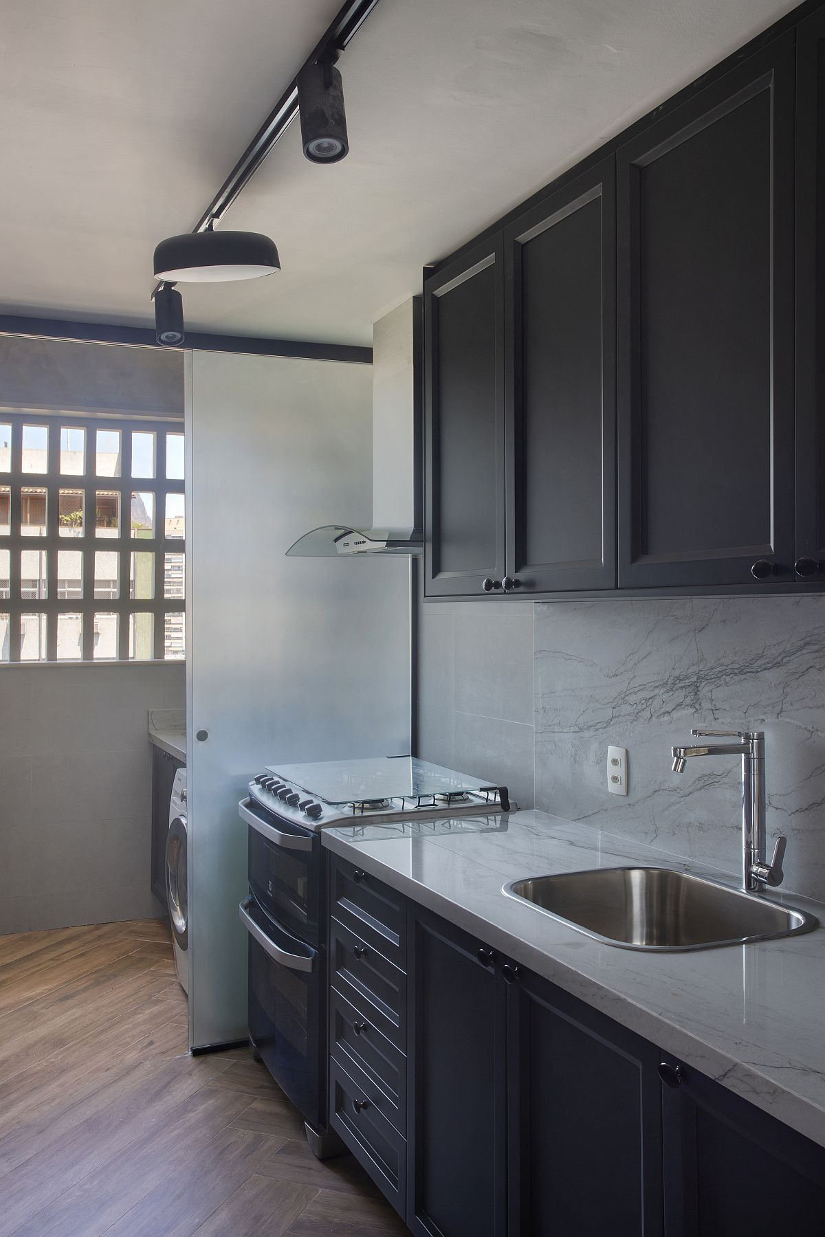 Finding space for the laundry unit inside the kitchen