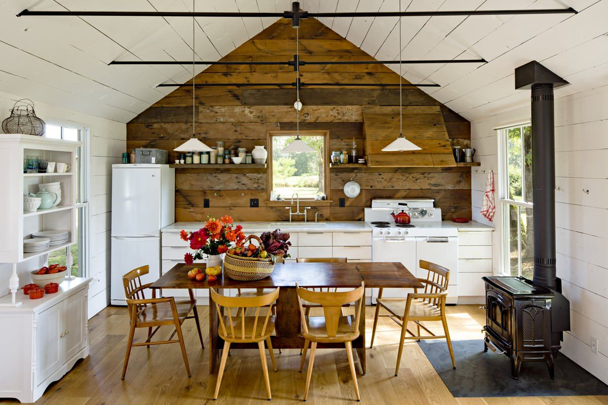 Fireplace in this modern rustic kitchen becomes an instant focal point