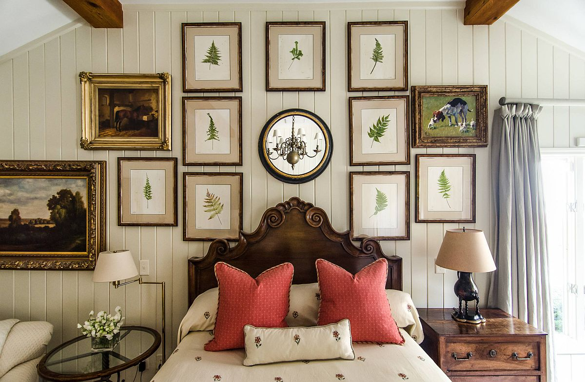 Framed botanicals in the backdrop add a green tinge to the bedroom