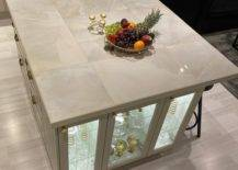 Fruit platter and candle holder on tiled countertop