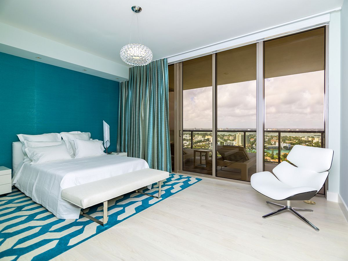 Gorgeous contemporary bedroom of Miami home embraces Benjamin Moore Color of the Year 2021 - Aegean Teal
