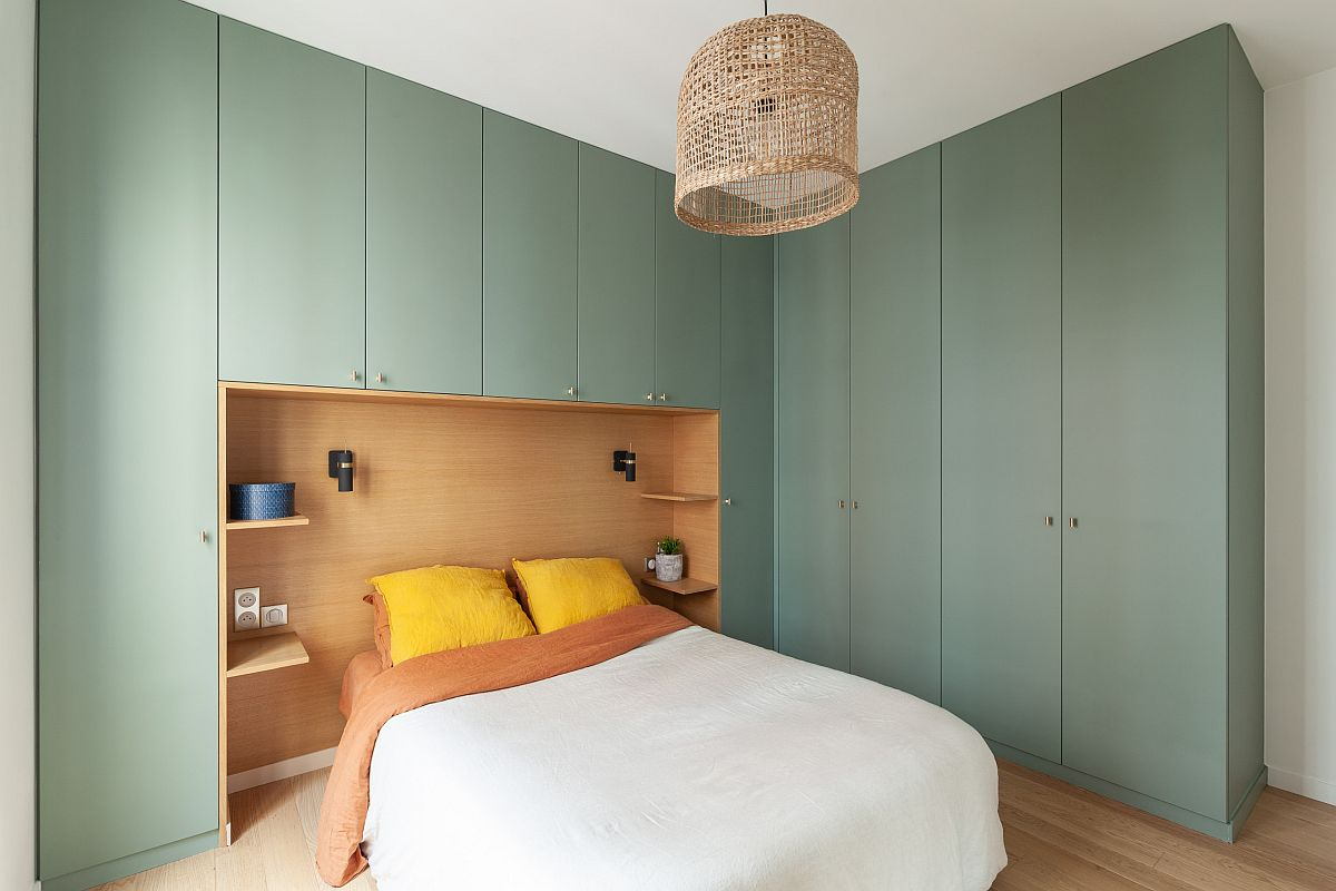 Gorgeous light green cabinets for the modern Paris bedroom bring color and contrast