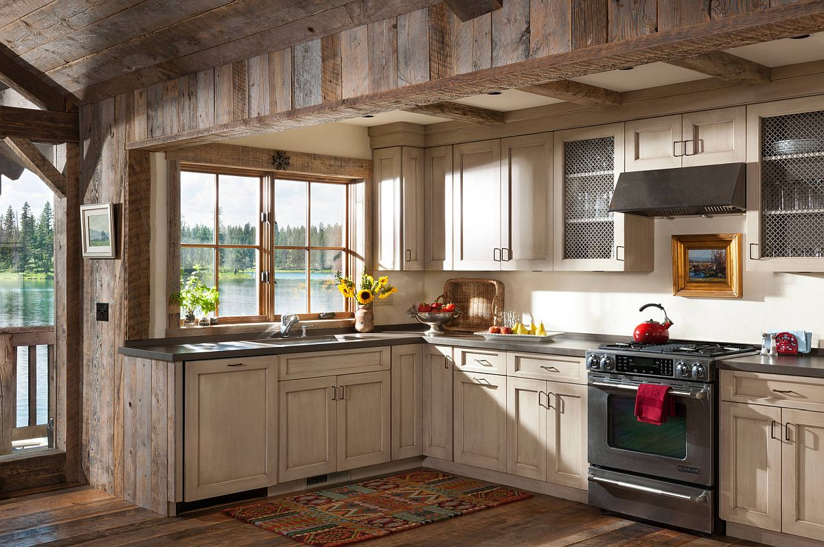Gorgeous rustic kitchen with weathered woodsy cabinets and ample natural lighting