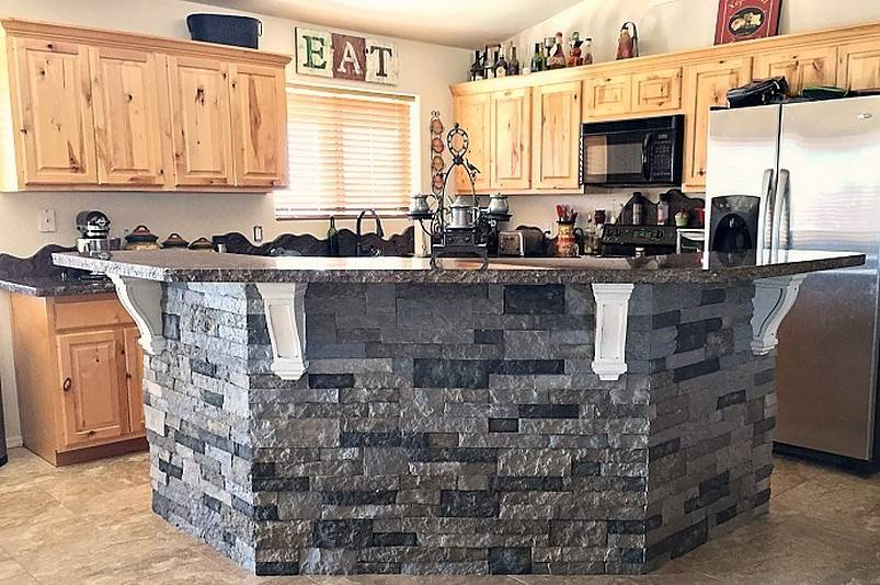 Gray kitchen island with granite and stones