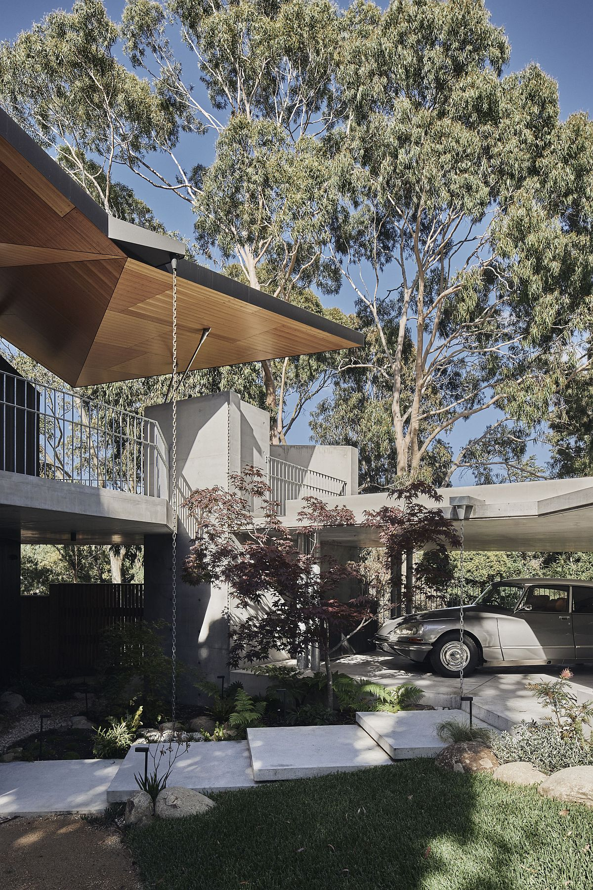 Green outdoors and entry of the unique Aussie home that feels different