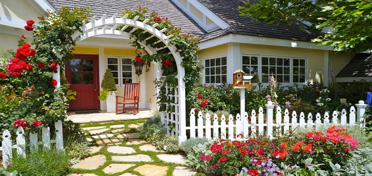 House front with arch and red flowers