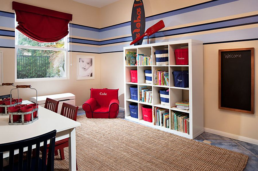 Kids' room with nautical style fetaures an open shelf for toy storage along with baskets