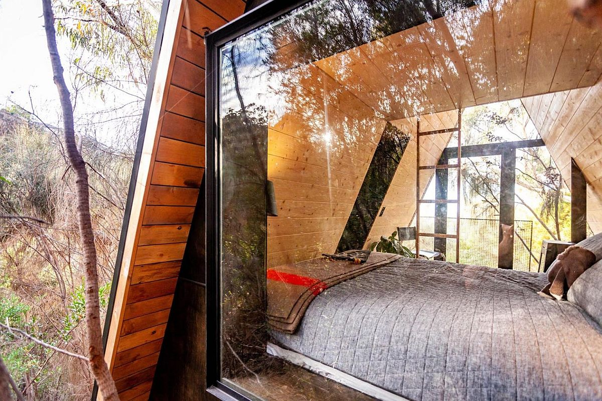 Large glazed windows bring ample natural ligt into the fun A-frame hangout