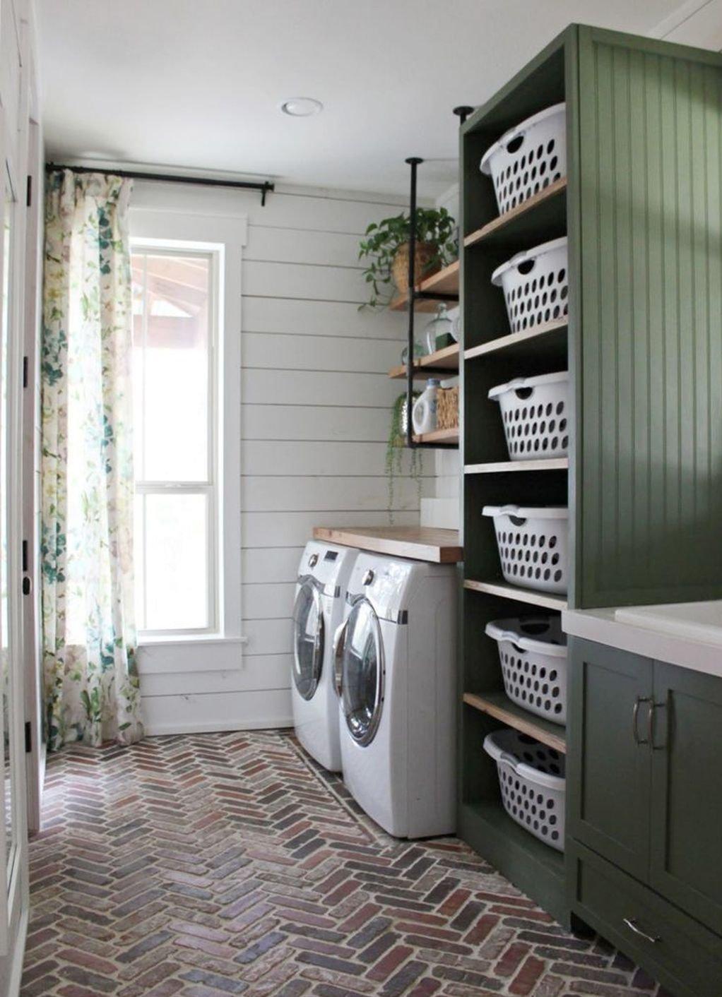 Laundry room with herringbone flooring