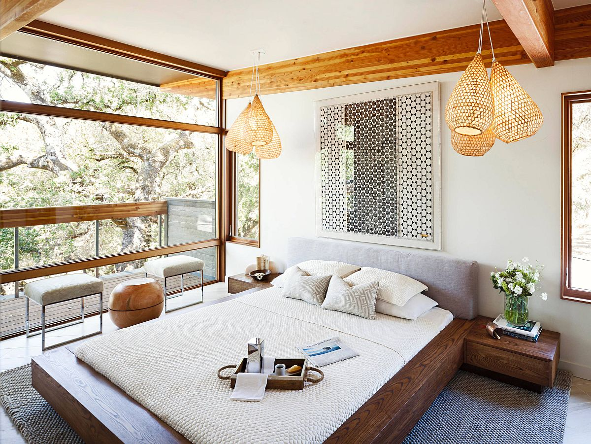 Light-filled and modern bedroom with simple Scandinavian style that has a Zen-inspired look