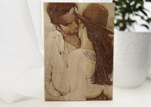 Man kissing a woman in wood photo