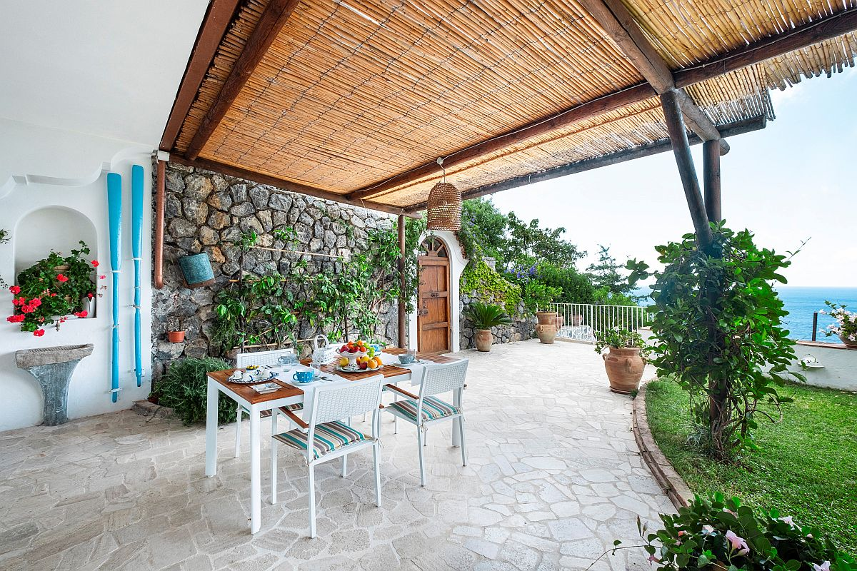 Mediterranean style deck and pergola offers ample shade