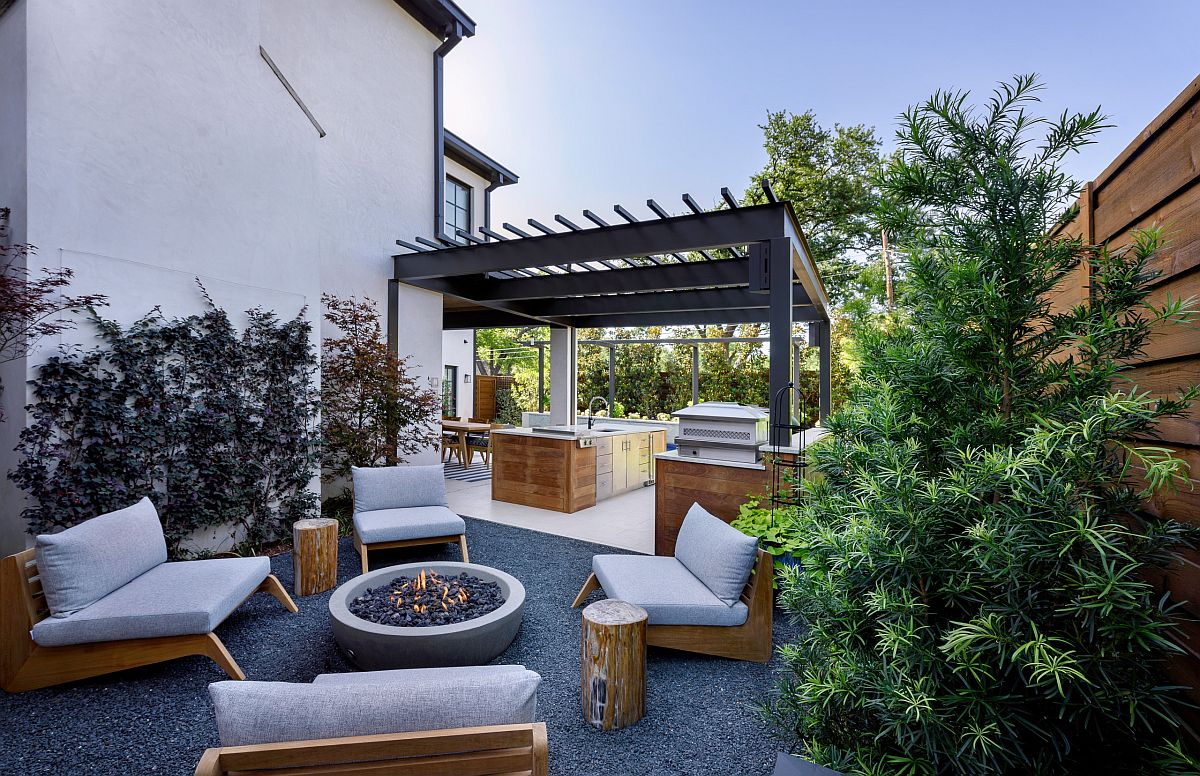 Metallic structure of the pergola feels like a natural extension of the home next to it