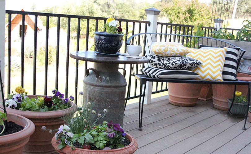 milk can side table on porch