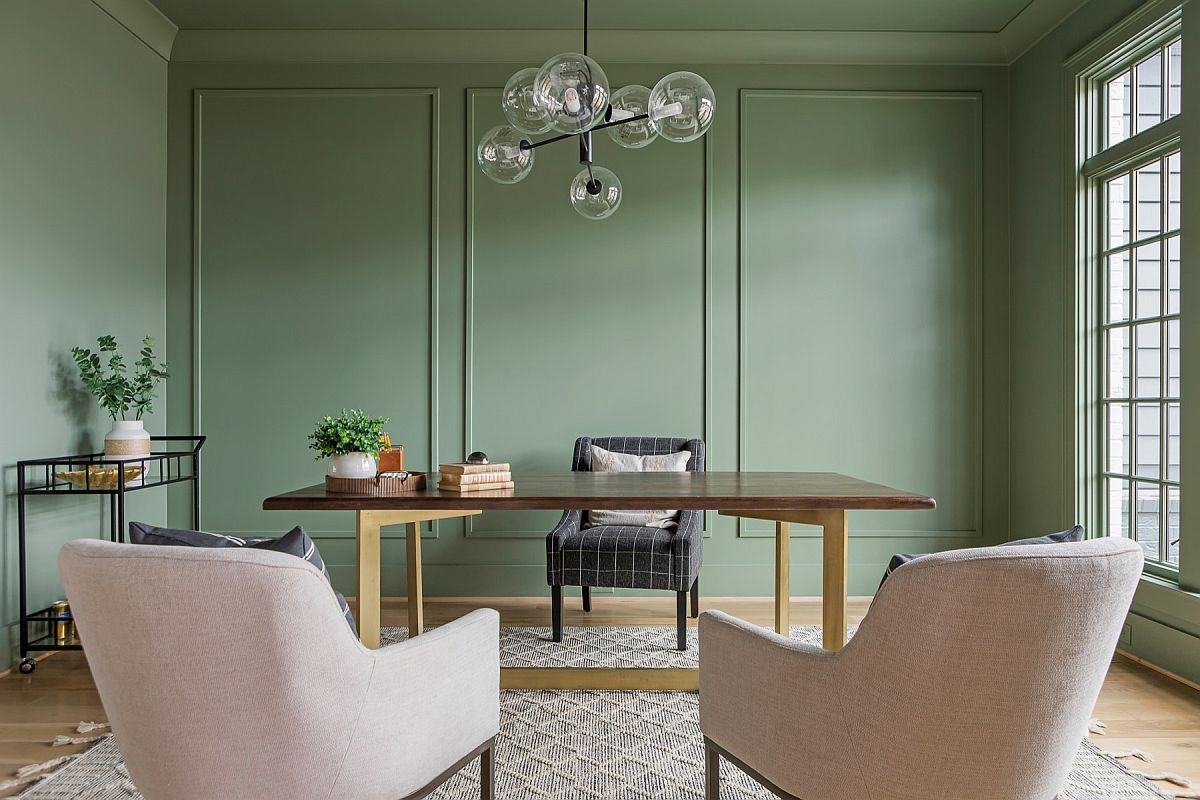 Modern home office combines the beauty of pastels with the charm of green