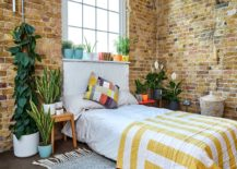 Modern-industrial-bedroom-with-brick-walls-and-greenery-all-around-44455-217x155