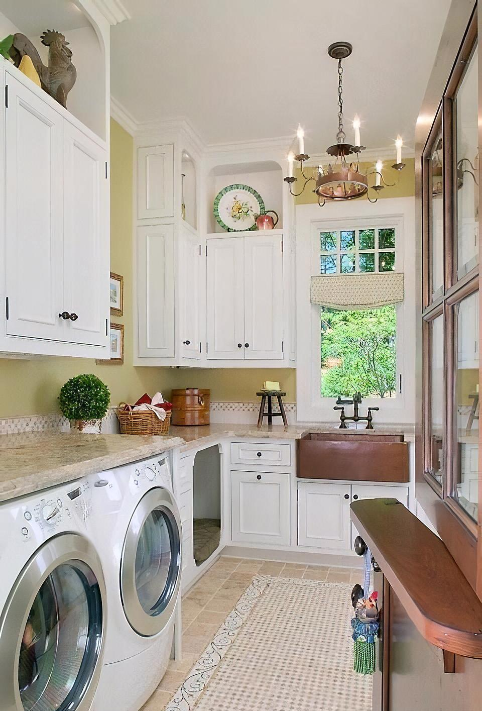 Modern laundry room with chandelier