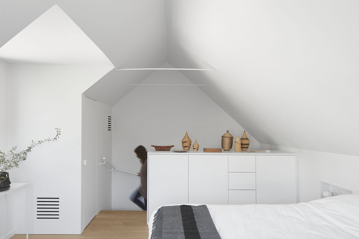 Modern minimal bedroom in white on the upper level of the home