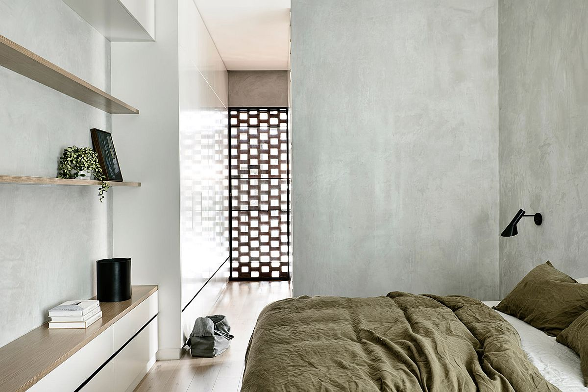 Modern minimal bedroom with gray walls and ample natural light on he upper level