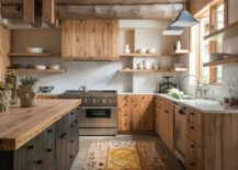 Modern-practicality-coupled-with-rustic-elements-like-wooden-ceiling-beams-and-woodsy-cabinets-in-the-kitchen-36815-217x155