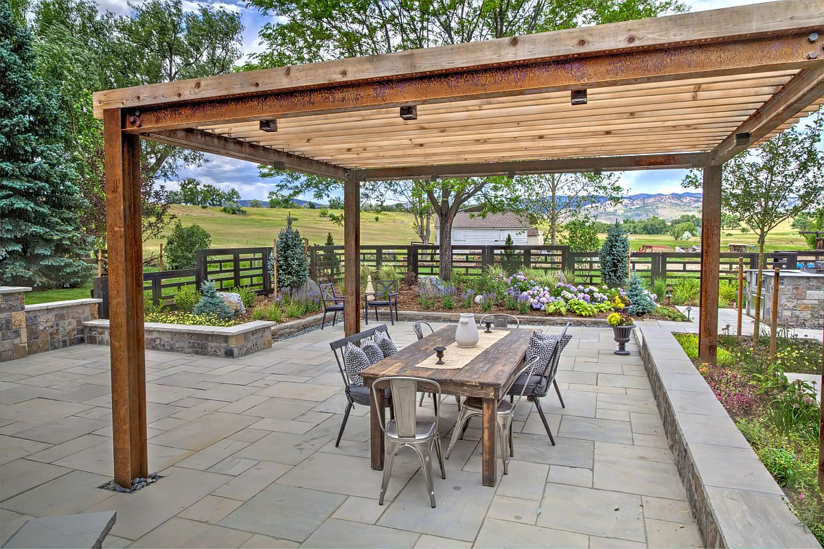 Modern rustic patio with oudoor dining area and a standalone pergola structure