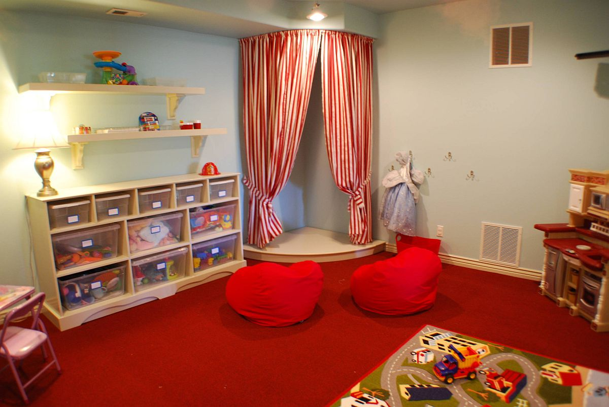 Neatly stacked storage boxes in the kids' room occupy the small shelves and make things accessible for kids