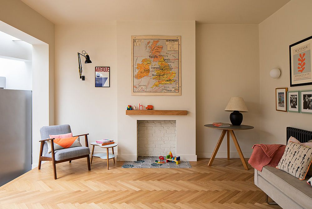 New elevated family area of the home with herringbone pattern floor in wood and white walls