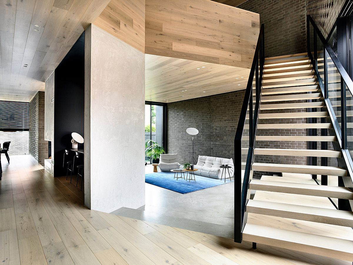 New, open plan living area of the house on the lower level wih raised platforms creating series of spaces