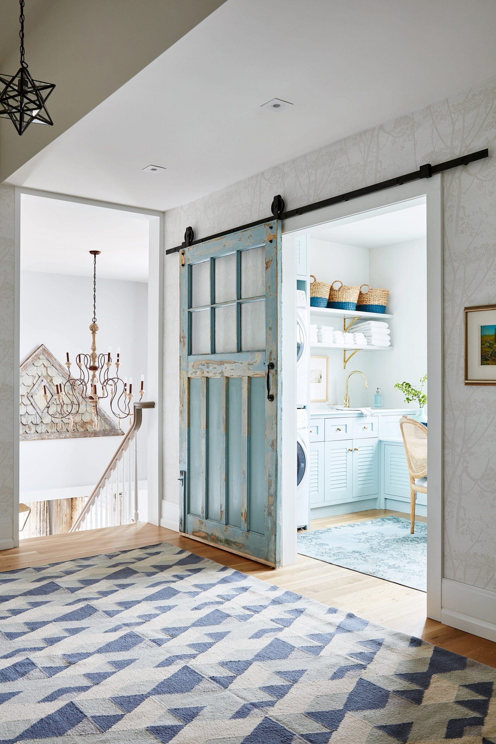 Old blue sliding door and chandelier with light bulbs