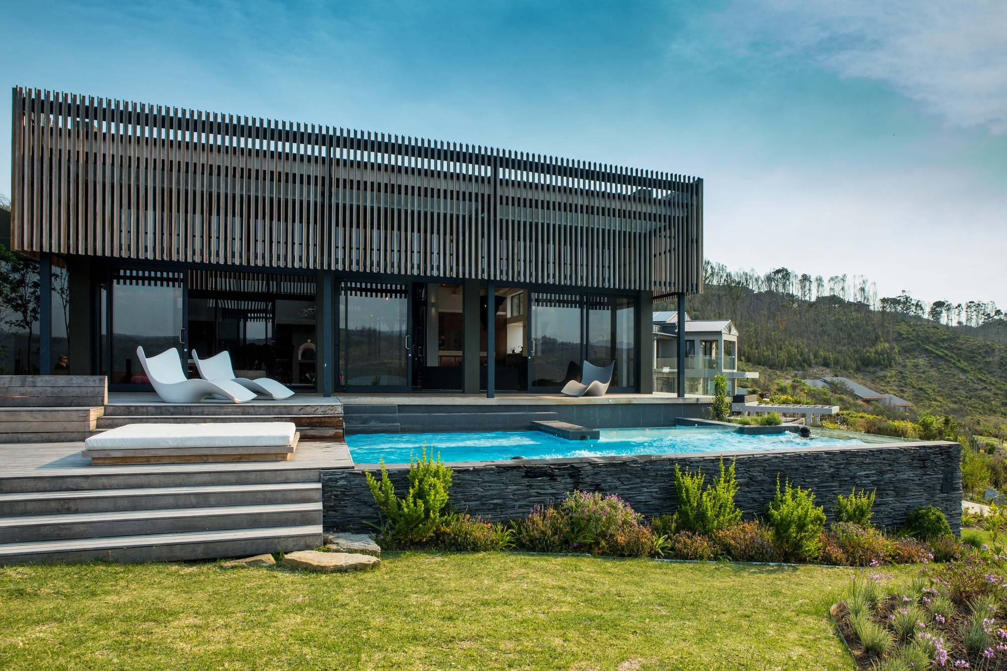 Outdoor pool area and hangout of the South African home with fabulous views of the outdoors