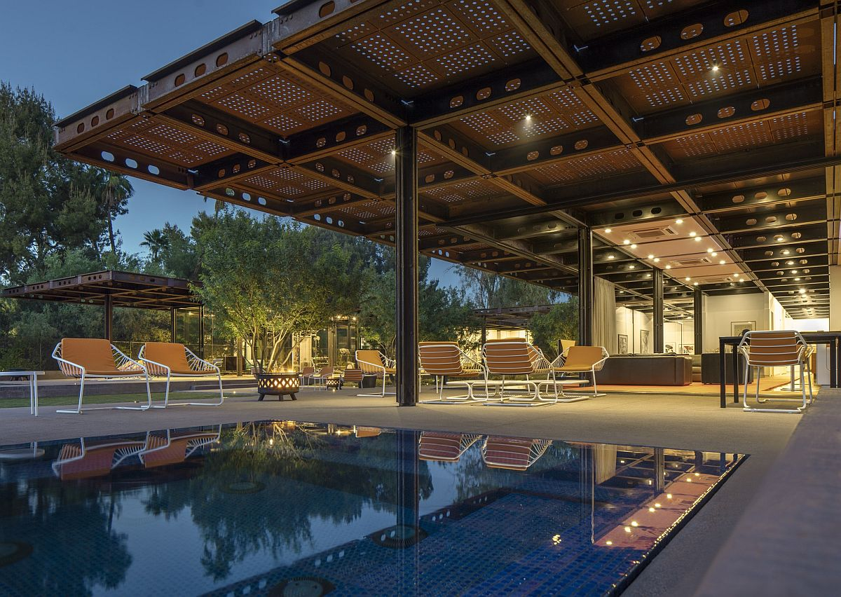 Perforated corten sheets around the pool ensure that there is ample shade next to the pool