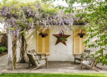 Pergola-structure-is-entirely-covered-in-vines-giving-it-a-dreamy-whimsical-charm-22905-217x155